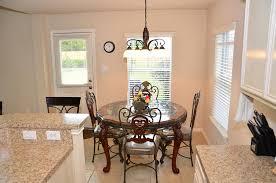 the breakfast area features decorative lighting access to the backyard tile flooring breakfast area lighting