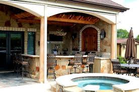 covered patio freedom properties: another view of this patio cover by archadeck of austin shows just how much versatility this space offers an outdoor bar and gully functioning outdoor