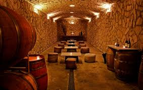 luxury wine cellar design with natural wall pattern with lighting plus low dining set cellar lighting
