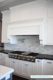 carrara marble tiles kitchen
