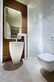 modern pedestal sink bathroom contemporary with concrete floor contemporary curved avant garde faucet