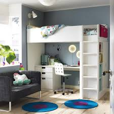 a room with a white loft bed combination that includes a desk chest of drawers boys bedroom furniture ideas
