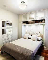 beautiful white bedroom design with space saving murphy bed and wooden floor small large beautiful bedroom furniture small spaces