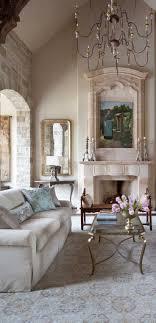 living room carolina design associates: tuscan mediterranean living room chandelier fireplace