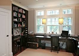 traditional home office idea in boston with a built in desk built home office designs