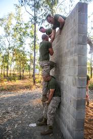 u s department of defense photo essay u s marines help each other scale a wall on an obstacle course during a weeklong squad