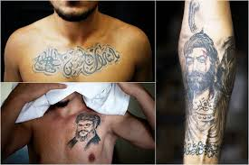photos  photo essay  shiite muslims tattoo themselves as a show of    shiite muslims  shiite muslim tattoos  religious tattoos  tattoos in    syrian religious