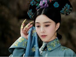 Photos show Fan Bingbing, a famous Chinese actress, in the costume of a queen in Qing Dynasty (1644-1912) in Chengde Summer Resort in Hebei Province. - F201306281649195906203635
