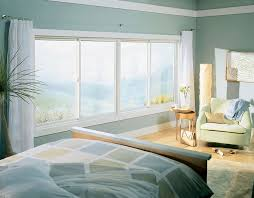 two white gliding windows fill large opening allowing natural light in allowing natural light fill