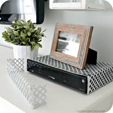 17 best ideas about hide tv hidden tv tv storage easy way to hide a cable box