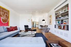 spacious living room idea of bachelor pad furniture design with large white couch with round coffeetable bachelor bedroom furniture