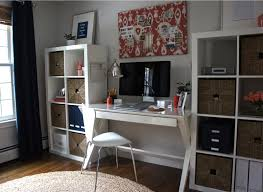 today i am featuring jessicas office makeover at home with baxter i love the look of the navy blue white and coral color scheme and how jessica brought blue white home office