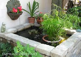 diy patio pond: formal raised pond with paving stones