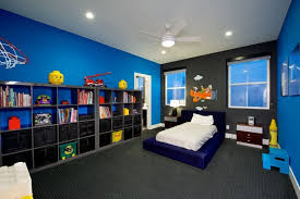 girls room playful bedroom furniture kids: a more traditionally masculine kids room featuring bright blue walls and a single charcoal gray accent