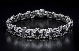 A dramatic bracelet featuring premium natural 8mm <b>lava</b> rock beads ...