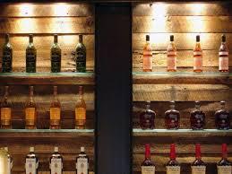 back bar detail reclaimed wood steel and glass back bar lighting