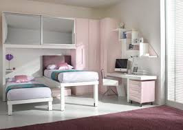 charming kids girl room with two bed with violethead board pink cabinet white desk and violet rug dweefcom interior decorating furniture and interior charming kids desk