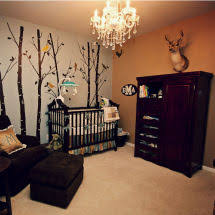 teal green gold and blue woodland baby boy nursery theme room with deer and forest animals baby furniture rustic entertaining modern baby