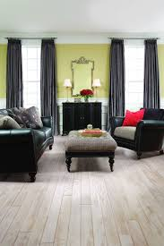 beautiful image of home interior design and decoration using grey wood laminate home flooring delectable black green living room home