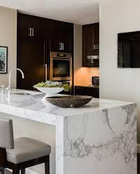 calacatta marble kitchen waterfall: terrat elms interior design kitchens waterfall edge counter marble waterfall edge counter