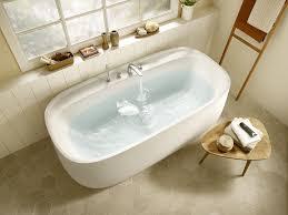 Отдельностоящая <b>ванна из материала</b> Surfex® со смесителем ...