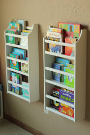 magazine rack wall mount: wood wall mounted magazine rack shelves ideas with white color for play room decor