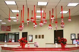 work office decor ideas decorating at beautiful decorations for handcrafted red ribbon hanging on white ceiling attractive cool office decorating ideas