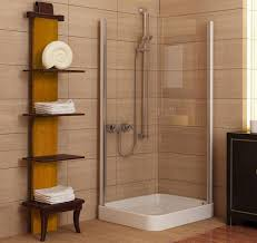 bathroom ideas corner shower design: cream bathroom wall tile patternes with corner shower area and tall shelf also sea shell ornament