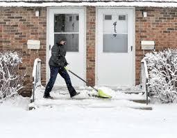 winter returns news sports jobs messenger news messenger photo by hans madsen rhonda williams of fort dodge works on clearing