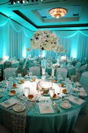 soft blue lighting with white blush and green centerpieces tiffany blue wedding uplighting http blue wedding uplighting