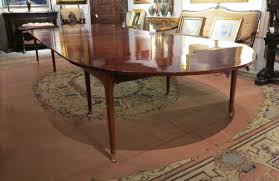 elegant square black mahogany dining table: a louis xvi mahogany dining table