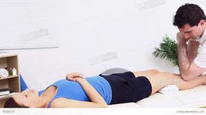physiotherapist using his elbow to massage a w stock video physiotherapist using his elbow to massage a w stock video footage