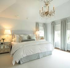 windows on each side of bed w side tables lamps lighting above bed above bed lighting