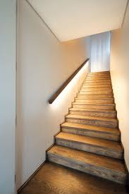 the staircase and the upstairs flooring is oiled oak led lighting under the handrail gives absolutely nicking lighting idea