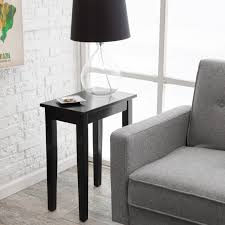 black polished oak wood nightstand with skirt and tapered legs added black shade table lamp placed captivating side table