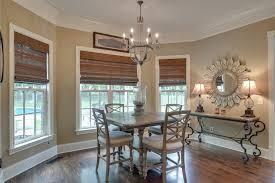 breakfast area with windows overlooking back yard and pool hardwood floors and designer lighting breakfast area lighting