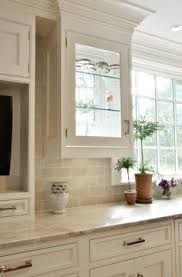 countertops popular options today: beige subway tile kitchen traditional with beaded inset custom cabinetry