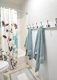 guest bathroom towels: hooks for a kids bathroom instead of a towel bar makes it easier for the kids
