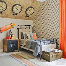 zones bedroom wallpaper: can we say were totally jealous of the kid that gets to sleep in this bedroom in addition to the fabulous industrial decor and fun pops of orange