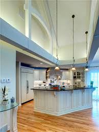 among the outstanding features of this kitchen are its 15 ft high cathedral ceiling and awesome cathedral ceiling lighting 15