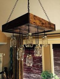 diy pallet mason jars chandelier alternating length wagon wheel mason jar