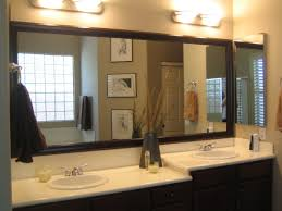 bathroom vanity mirror ideas modest classy: bathroom framed mirror big bathroom mirror design ideas with brown wooden frame feat stainless steel towel hook and porcelain vanity top bathroom combine tapering porcelain undermount sink and wall lights
