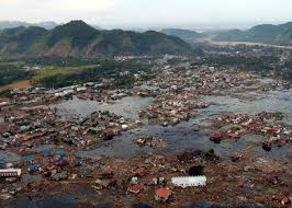 tsunami the killer wave the why files aerial view of flooded village debris strewn throughout mountains surround village