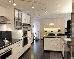modern design with white cabinetry and white wall also track lighting ideas plus dark flooring bedroom track lighting ideas