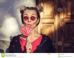 Blonde <b>Girl</b> In <b>Rose</b> Glasses Licking A <b>Lollipop</b> Stock Photo - Image ...