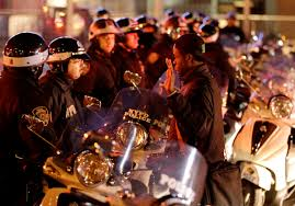 no such thing as racial profiling the new yorker a man stands his hands raised in front of a line of police officers during