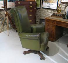leather desk chair with swivel actiona nice large leather desk chair the chair is covered with green leather and is mounted onto a wooden swivel base antique leather swivel desk chair