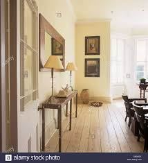 Stripping Dining Room Table Stripped Wooden Floorboards In Light And Airy Dining Room With