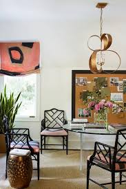 home office with round glass table and black bamboo chairs chic home office features