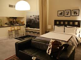 dark brown leather sofa and head board bed with white f cushions combined half round frosted ideas bedroomendearing living grey room ideas rust